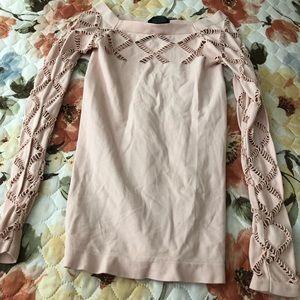 Bebe Lt pink cutout shirt size XS/S